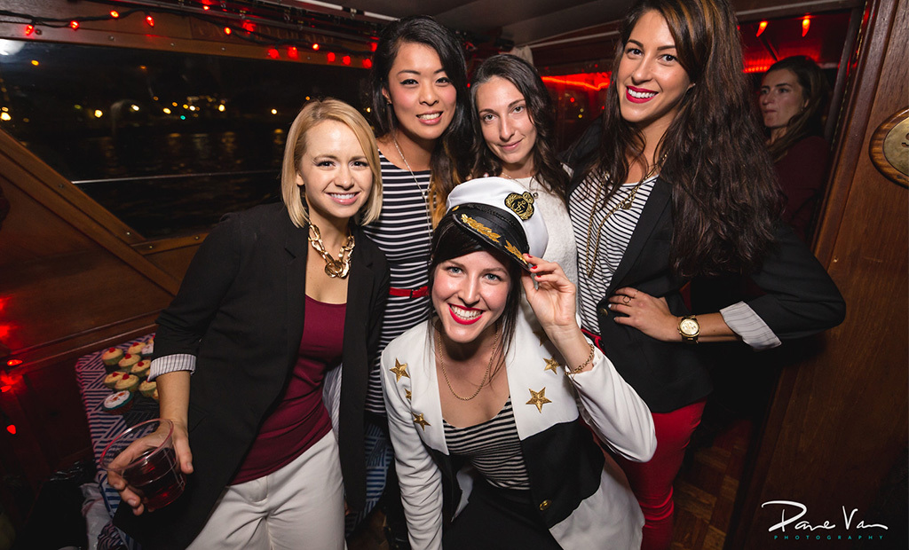 Bride-to-be and friends posing for the camera at their bachelorette party on the Fantasea.