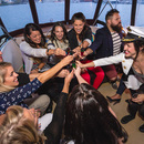 A bride-to-be toasts her bachelorette party aboard the Fantasea.